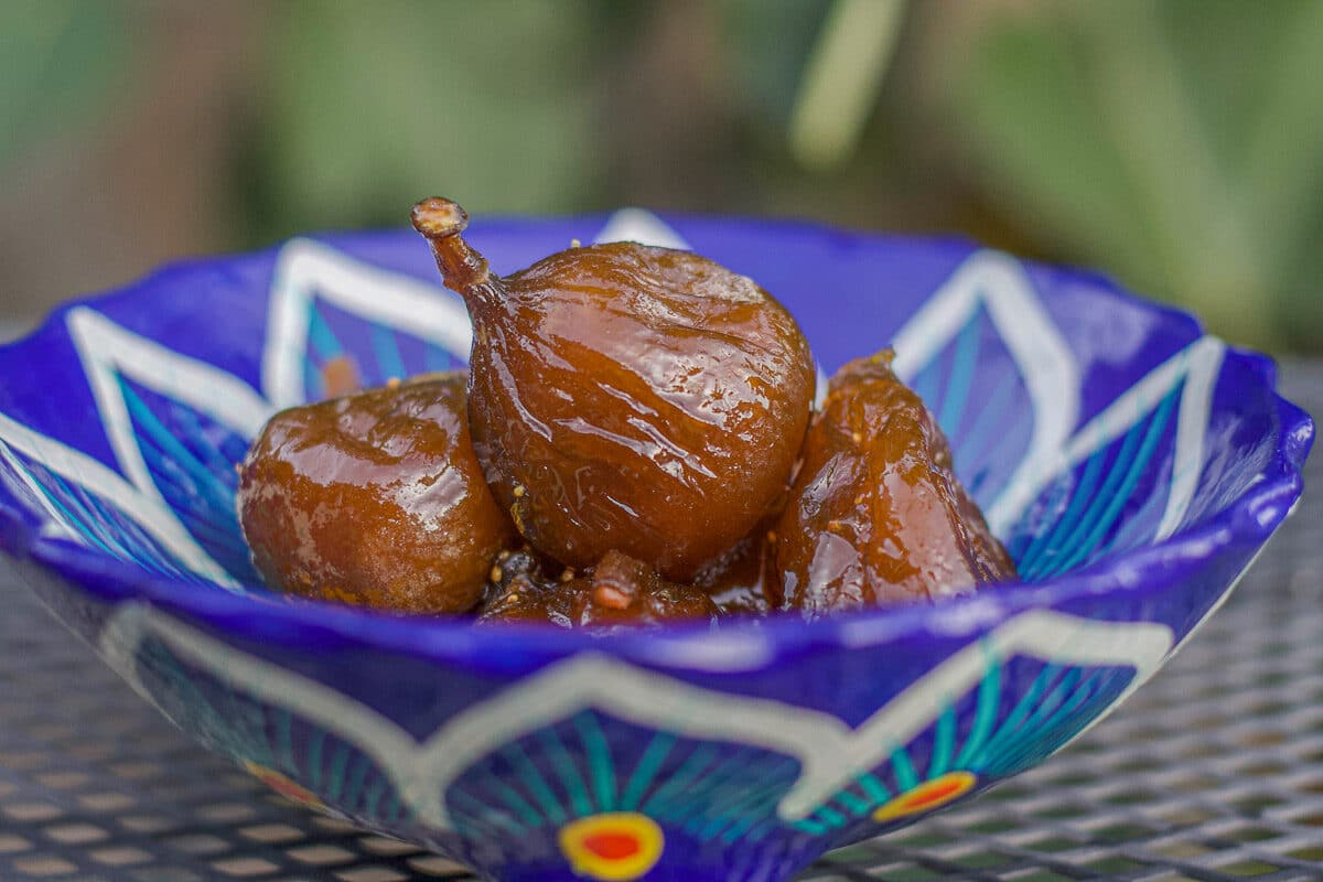 candied figs in a blue bowl