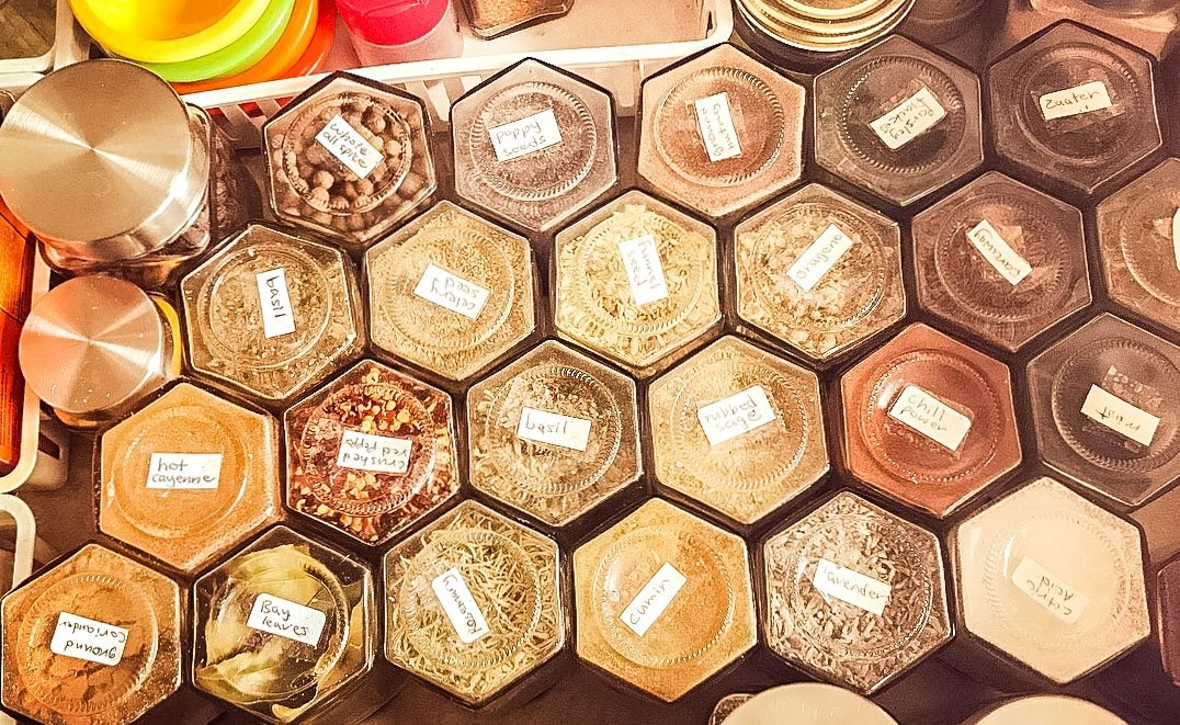 hexagon shaped bottles, filled with different spices
