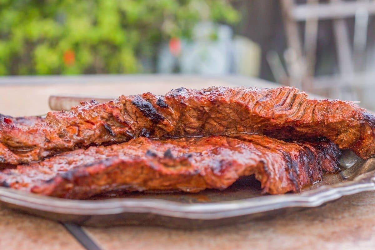 grilled carne asada on a tray