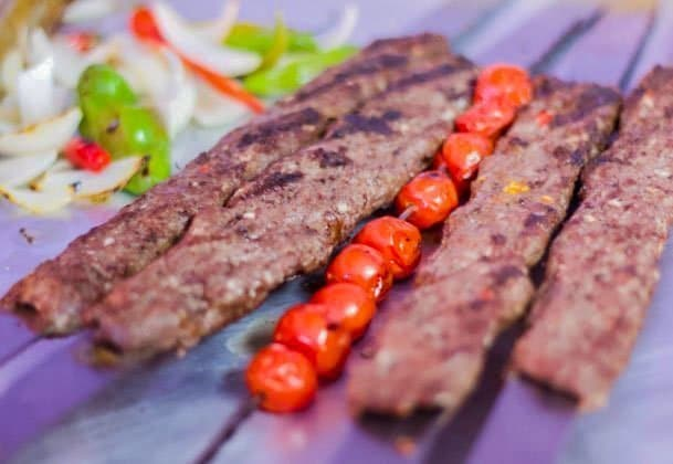 Goat Kofta Kabobs with skewered tomatoes and salad