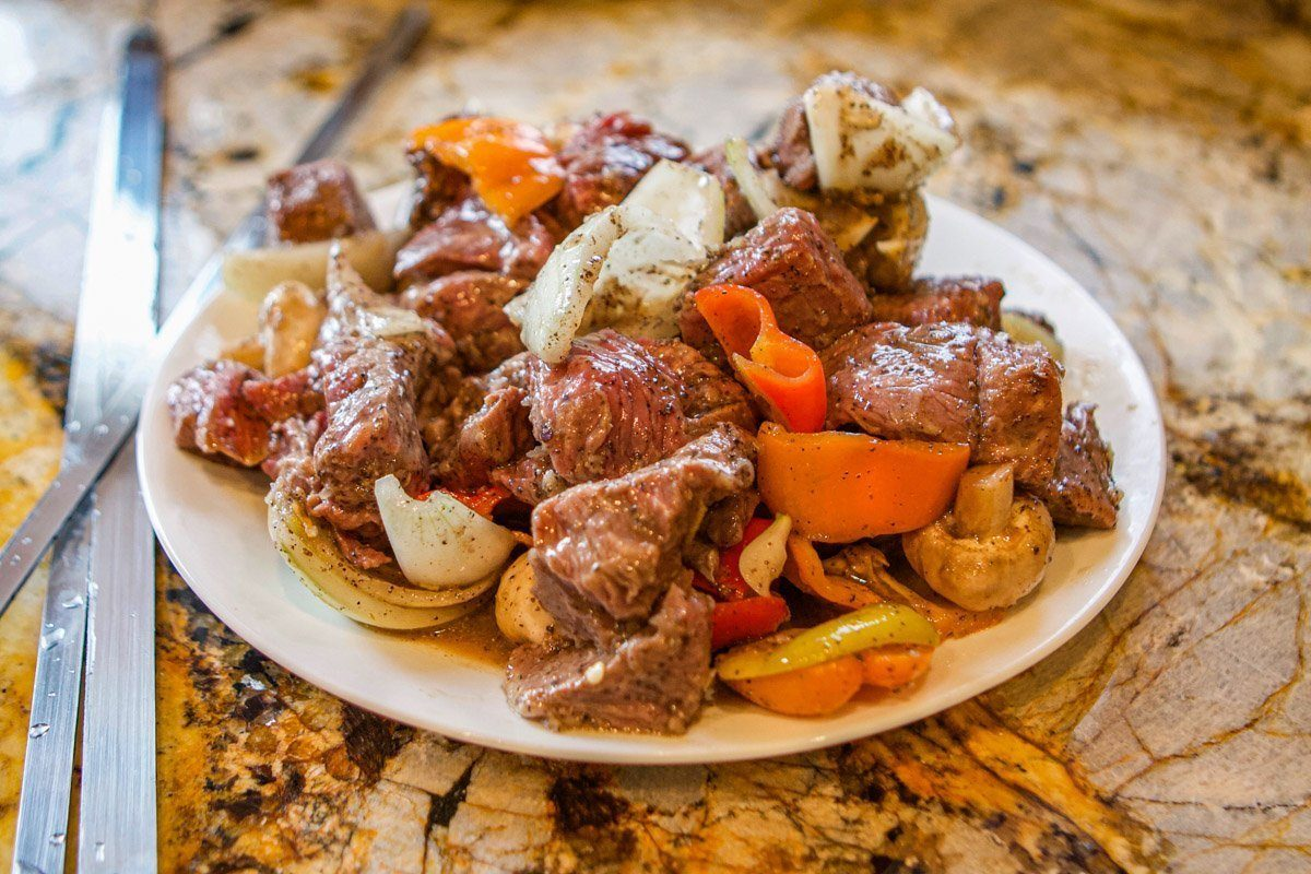raw shish kabob meat and vegetables on plate