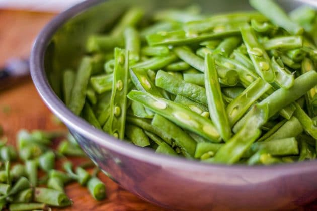 trimmed and sliced green beans in a bowl