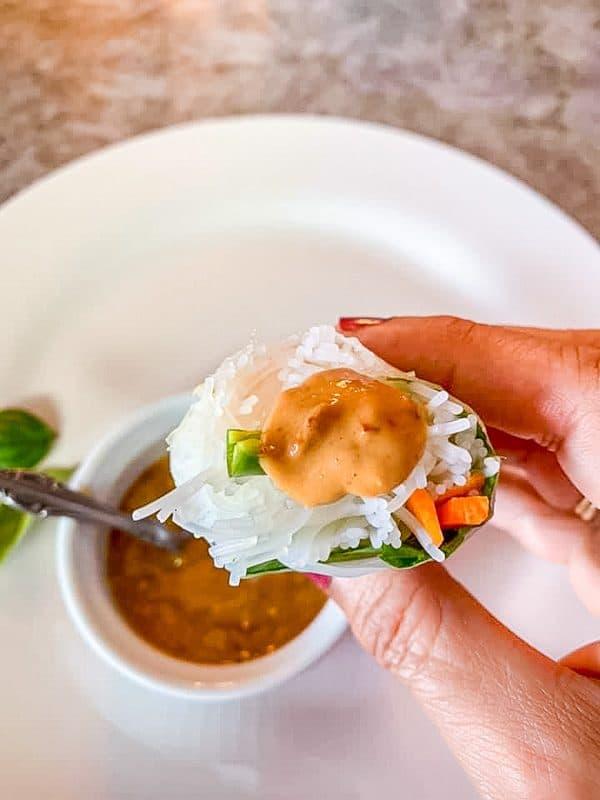 peanut dipping sauce on a springroll