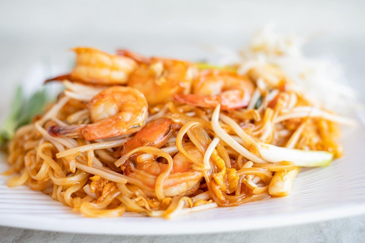 pad thai noodles on a white plate