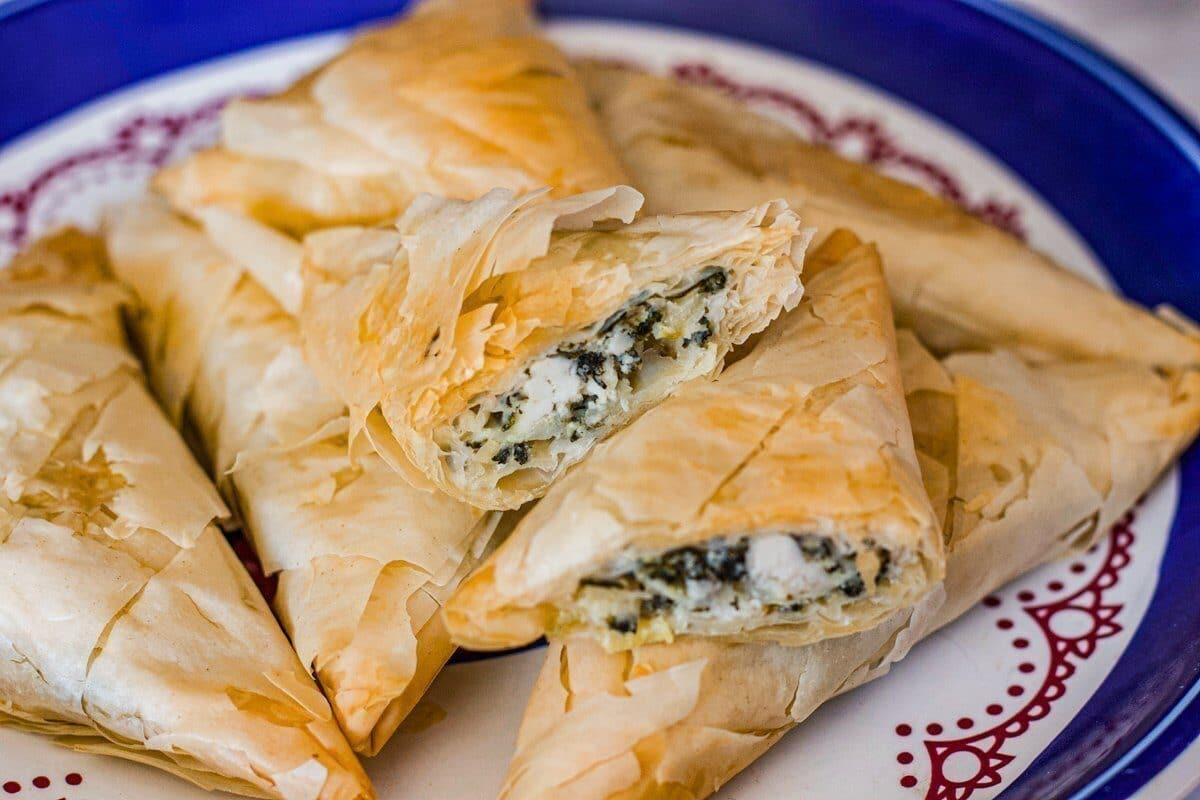 spanakopita on a plate with filling visible