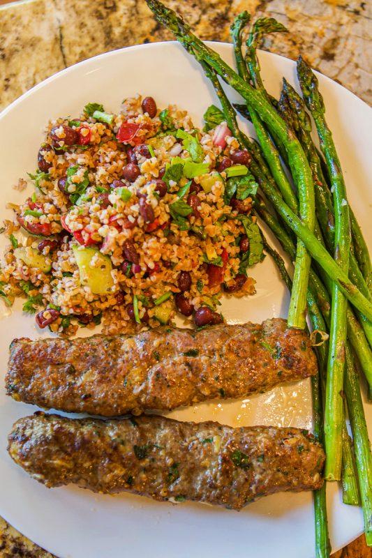 kofta kabob with rice and asparagus