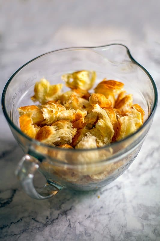 croissant chunks in measuring cup