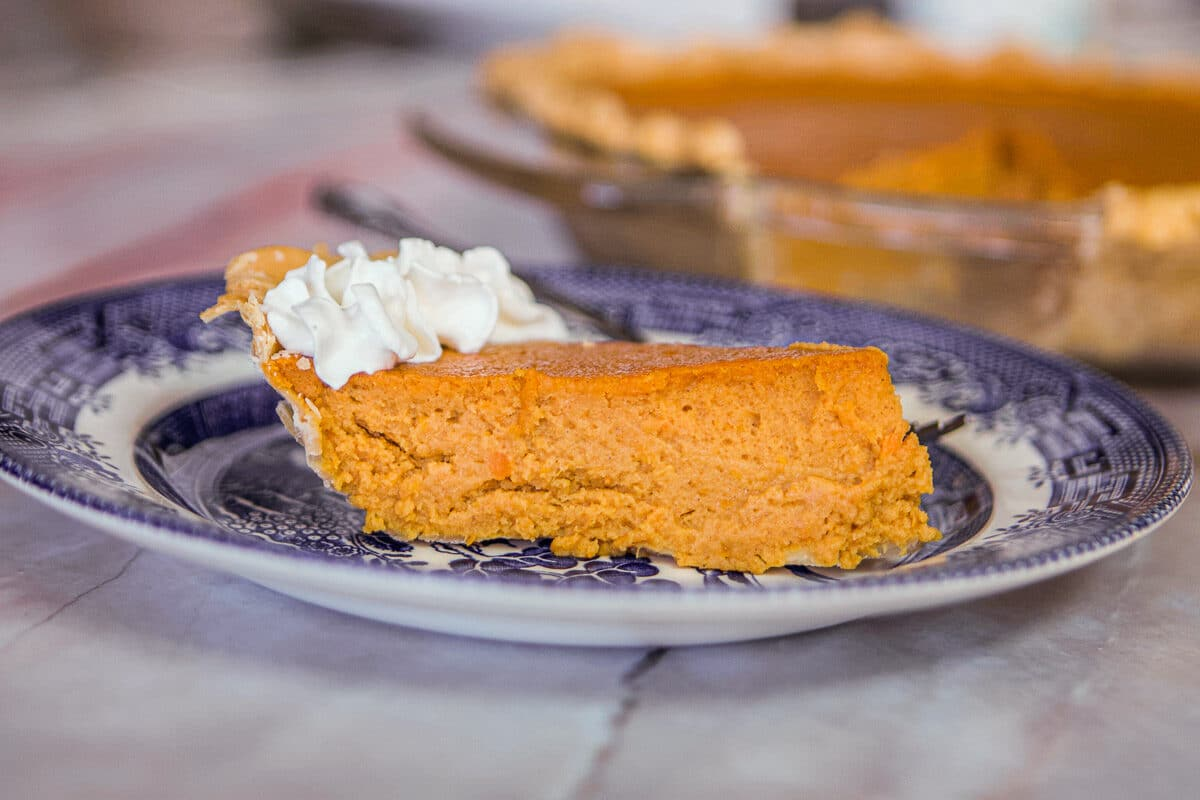 sliced sweet potato pie with whipped cream